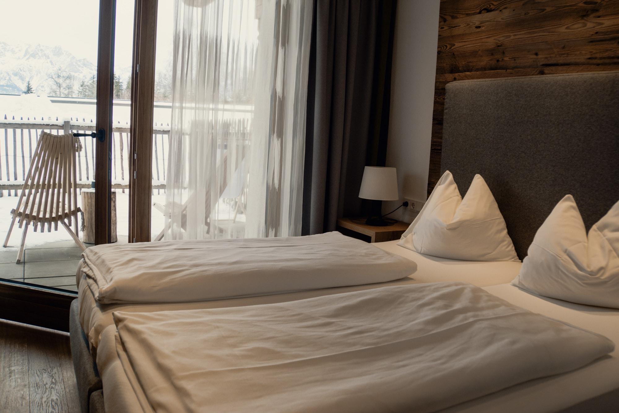 Puradies Leogang: Das Wellnesshotel und Skihotel direkt an der Piste - Schlafzimmer Suite